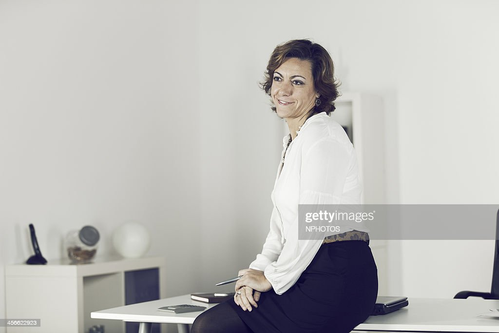 Businesswoman at the office : Stock Photo