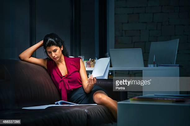 Businesswoman at the office working late.