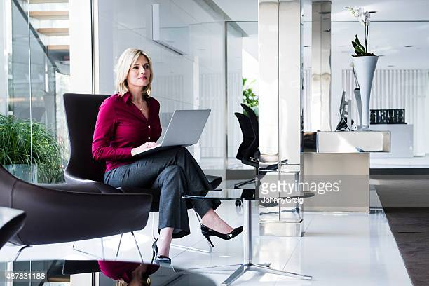 Businesswoman at work in modern office lobby