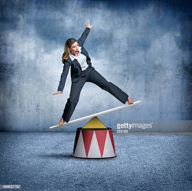 Businesswoman Balancing On A Circus Pedestal