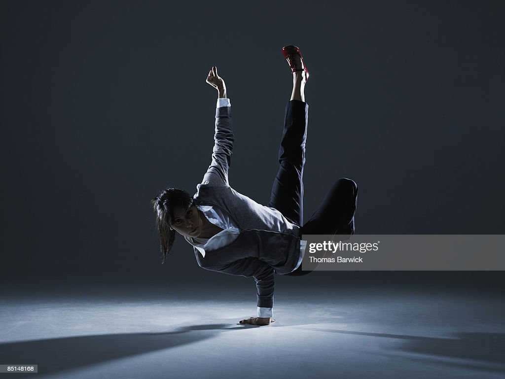 Businesswoman balancing on one hand : Stock Photo
