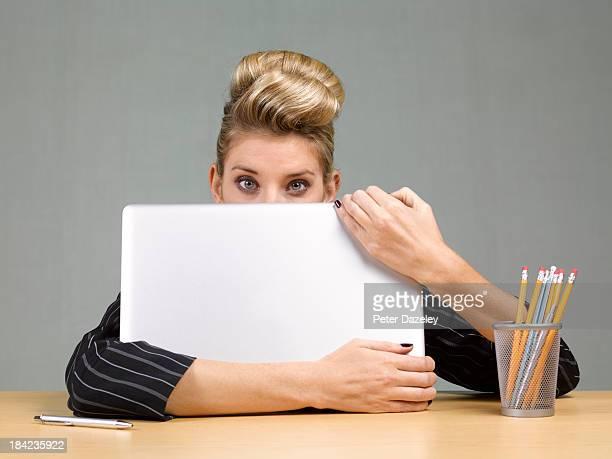 Businesswoman behind laptop