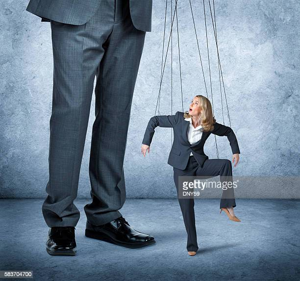 Businesswoman Being Controlled Like A Marionette