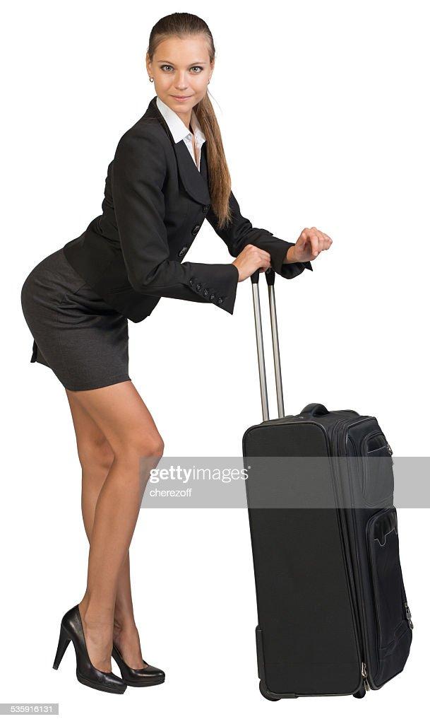 Flexão de Mulher de negócios para a frente, Inclinar-se na extensão pega de transporte, Mala : Foto de stock