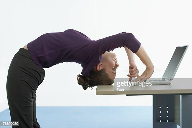 Businesswoman Bending Over Backwards