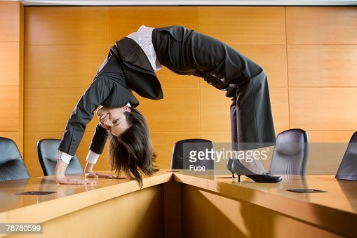 Businesswoman Bending over Backwards