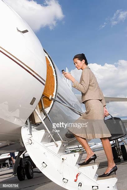 Businesswoman Boarding Plane