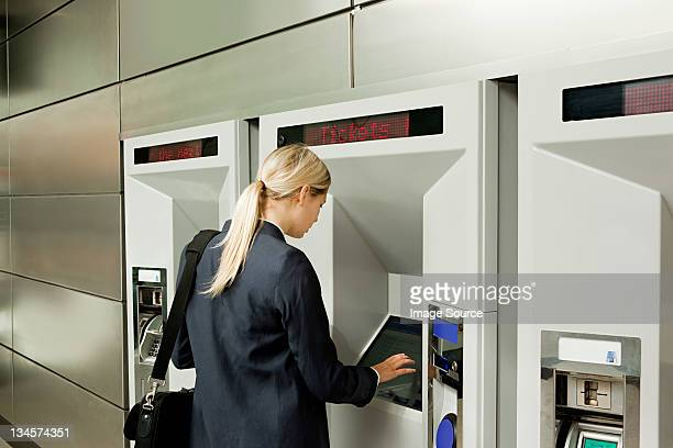 Businesswoman buying a train ticket