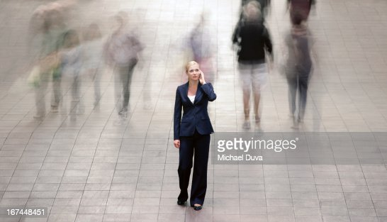 businesswoman calling using her cellphone : Stock Photo