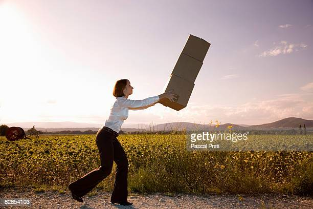 businesswoman carrying cardboard boxes