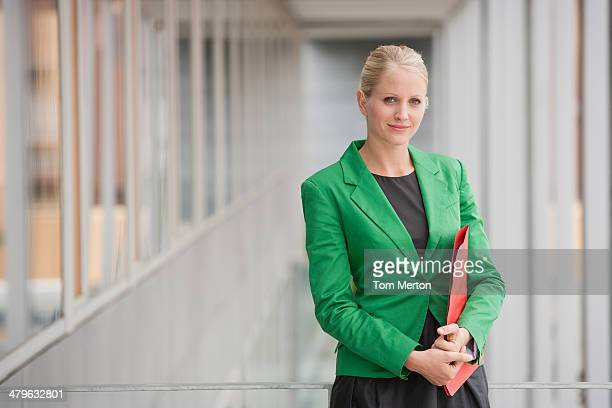 Businesswoman carrying file