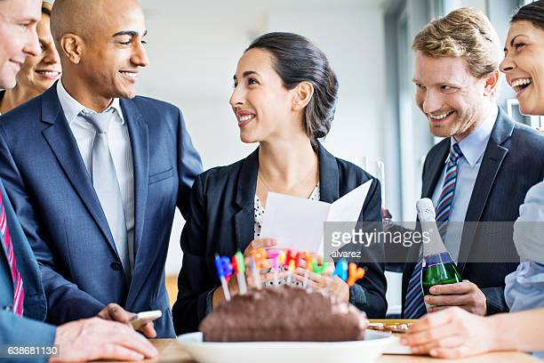 Businesswoman celebrating her birthday in office