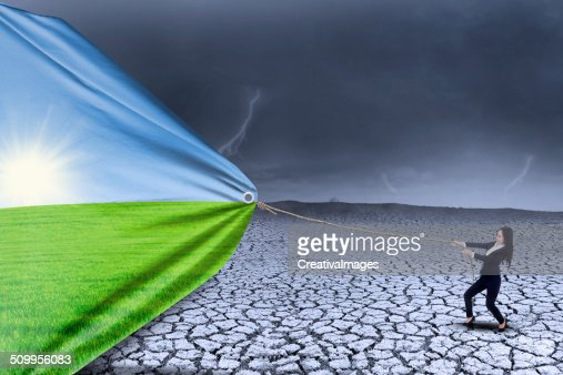 Businesswoman change landscape from dry to spring : Stock Photo
