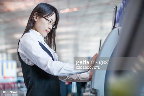 Businesswoman check in by auto check in machine