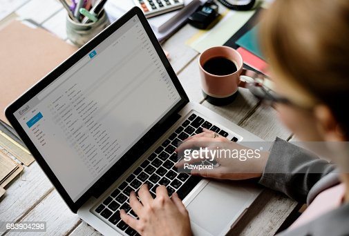 Businesswoman Checking E-mail Online on Laptop : Stock Photo
