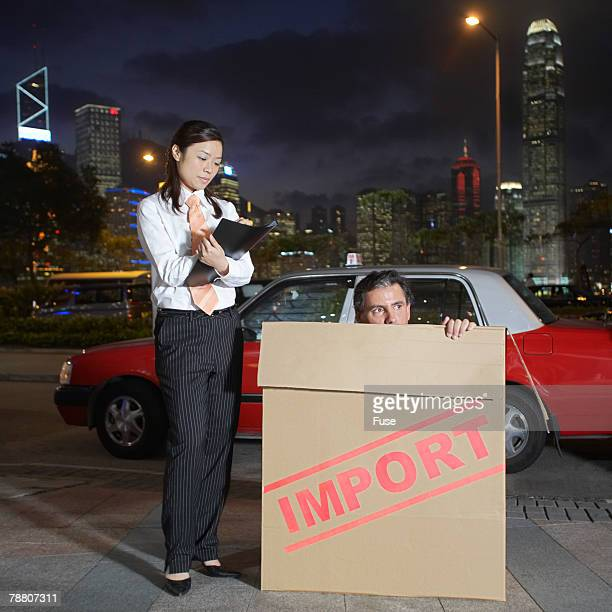 Businesswoman Checking Imported Businessman