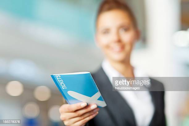 Businesswoman Checking in at the Airport