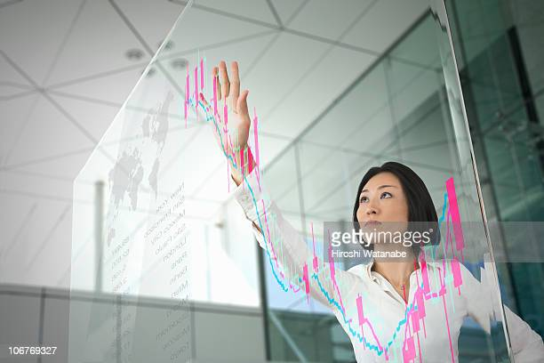 Businesswoman checking the stock chart