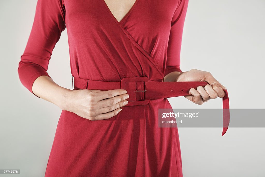 Businesswoman Cinching Belt