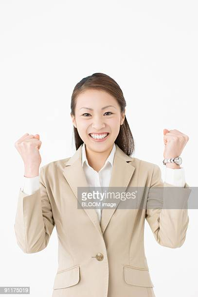 Businesswoman clenching fists, smiling