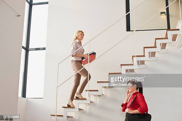 Businesswoman climbing stairs in office