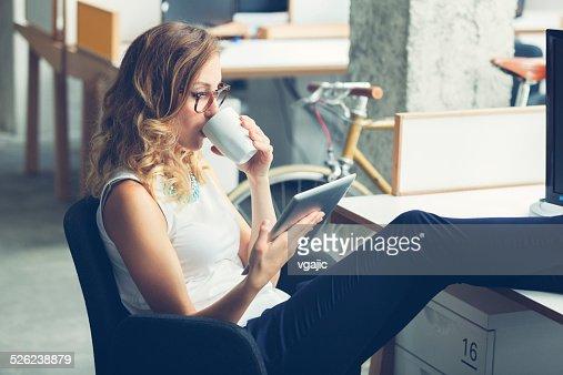 Businesswoman coffee break in office.