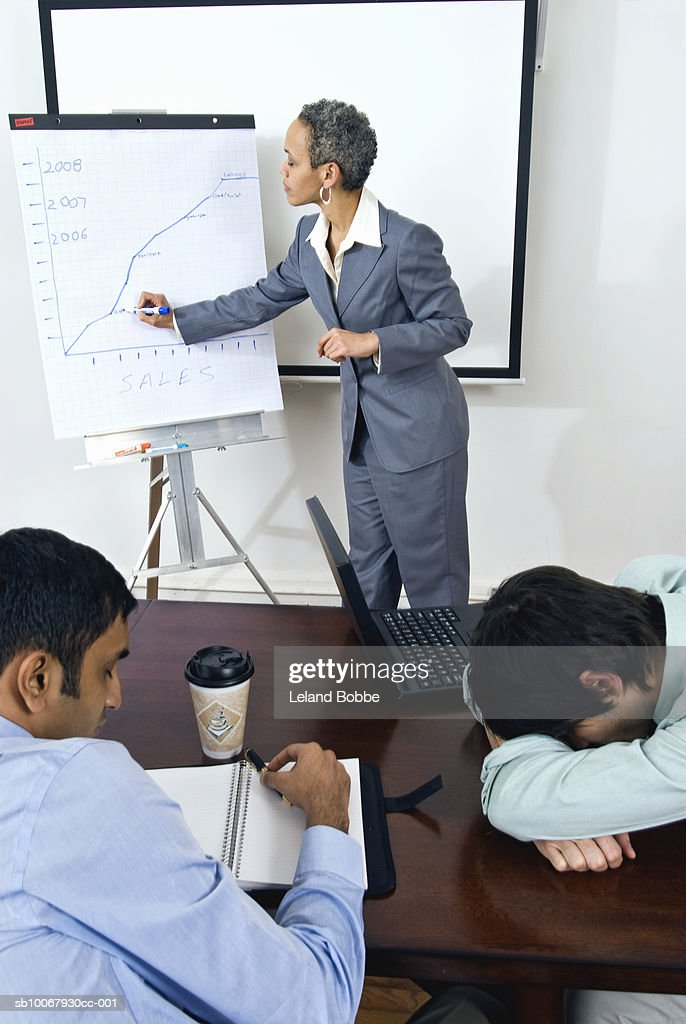 Businesswoman conducting boring business meeting : Stock Photo