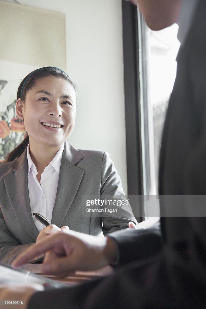 Businesswoman conversation : Stock Photo