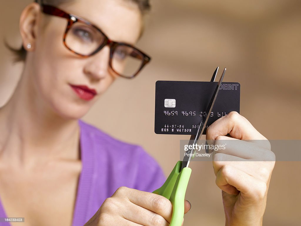 Businesswoman cutting up credit card