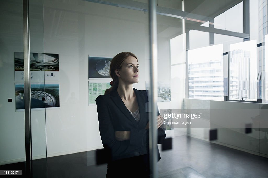 Businesswoman deep in thoughts : Stock Photo