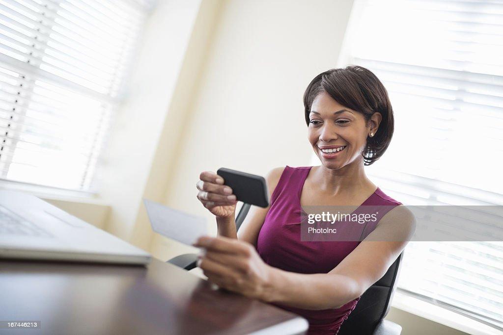 Businesswoman Depositing Check Through Smart Phone