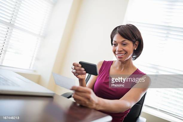 Businesswoman Depositing Check Through Smart Phone