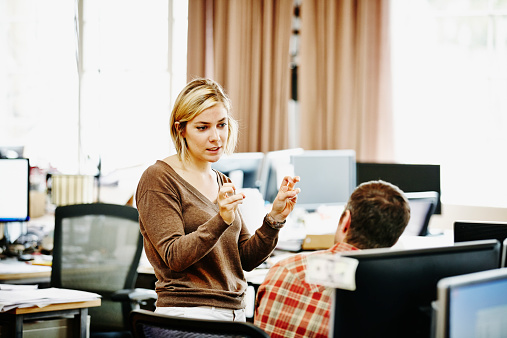 Businesswoman discussing project with coworker