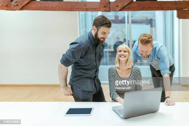 Businesswoman discussing project with her colleagues