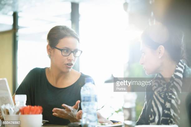 Businesswoman discussing with colleague in office