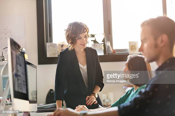 Businesswoman discussing with colleague