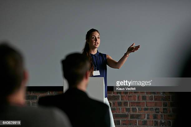 Businesswoman doing presentation at convention