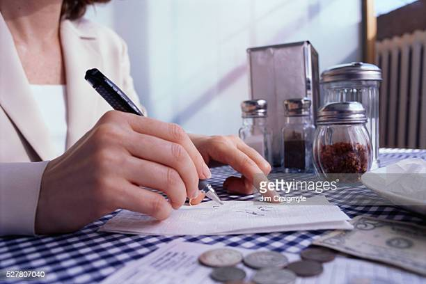 Businesswoman Drawing on Napkin