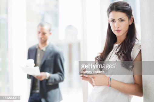 Businesswoman Drinking Coffee In Modern Office Stock Photo ...