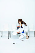 Businesswoman dropping files
