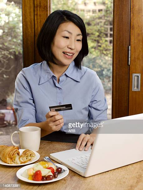 Businesswoman eating and shopping online