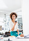Businesswoman eating lunch on desk