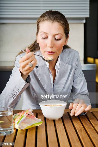 Businesswoman Eating Soup