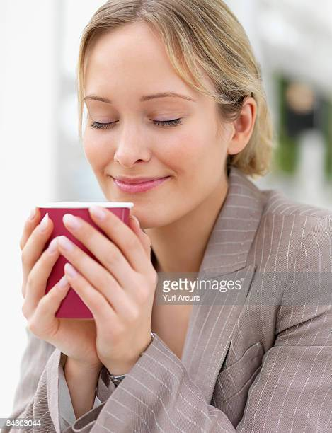 Businesswoman enjoying coffee