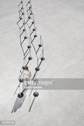 Businesswoman entering cordon posts : Stock Photo