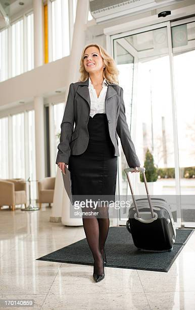 Businesswoman entering the Airport.