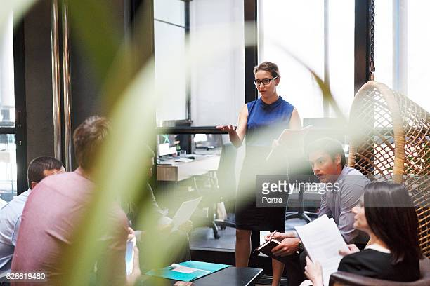 Businesswoman explaining strategy to colleagues