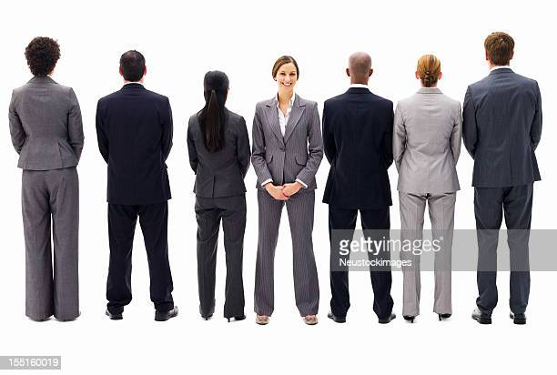 ビジネスウーマンに面したお仕事仲間との反対側から絶縁