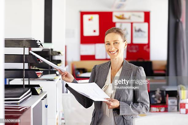 Businesswoman Filing Papers