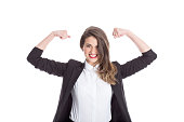 Enthusiastic businesswoman flexing her muscles; isolated on white.